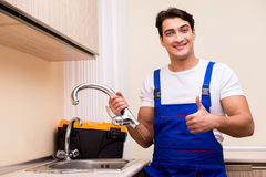 The young repairman working at the kitchen Royalty Free Stock Photos