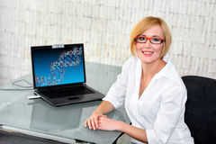 Young research engineer at glass desk with laptop Royalty Free Stock Images