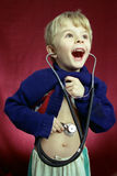 Young researcher. A little boy with the sthetoscope stock image