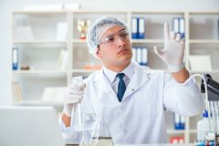 Young researcher scientist doing a water test contamination expe Stock Images