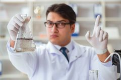 Young researcher scientist doing a water test contamination expe Stock Photos
