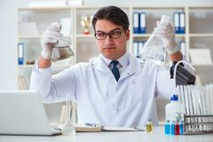 Young researcher scientist doing a water test contamination expe Stock Photography