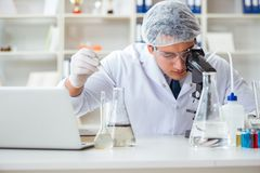Young researcher scientist doing a water test contamination expe Royalty Free Stock Images