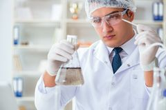 Young researcher scientist doing a water test contamination expe Stock Photo