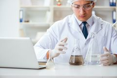 Young researcher scientist doing a water test contamination expe Stock Image