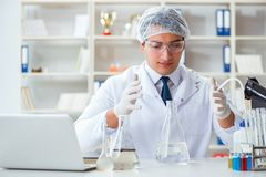 Young researcher scientist doing a water test contamination expe. Riment in the laboratory Royalty Free Stock Images