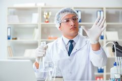Young researcher scientist doing a water test contamination expe. Riment in the laboratory Royalty Free Stock Image