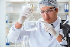 Young researcher scientist doing a water test contamination expe. Riment in the laboratory Royalty Free Stock Photo