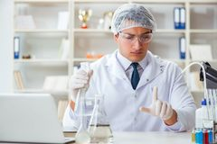 Young researcher scientist doing a water test contamination expe Royalty Free Stock Image