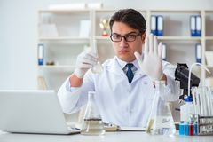 Young researcher scientist doing a water test contamination expe Royalty Free Stock Photography