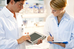 Young researcher using tablet PC Stock Photo