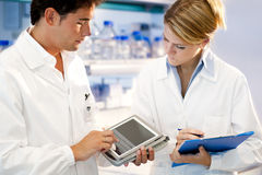 Young researcher using tablet PC. Consulting Royalty Free Stock Images
