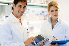 Young researcher using tablet PC Stock Image