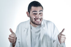 Young researcher. Wearing a labcoat smiling and with thumbs up Stock Photos