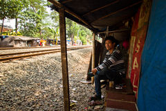 Young resident of the train track slums of central Jakarta, Indo Stock Image