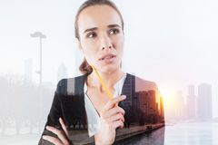 Young responsible worker looking thoughtful Royalty Free Stock Photos