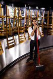 Young restaurant worker cleaning up Stock Images