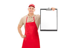 Young retail worker holding a clipboard Stock Photography