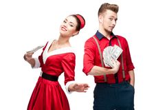 Young retro couple holding money Stock Images