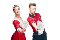 Young retro couple holding money Stock Image