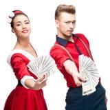 Young retro couple holding money Stock Photography