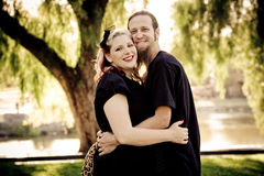 Young retro couple hugging in park Stock Photo