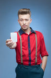 Young retro man holding empty card Royalty Free Stock Image