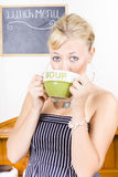 Pretty retro woman drinking hot cup of soup Stock Photos