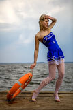 Young retro pinup girl with blond curly hair style and beau royalty free stock images