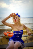 Young retro pinup girl with sexy blond curly hair style and beau Royalty Free Stock Photography