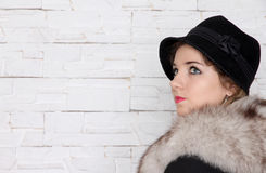 Young retro woman in the black hat Stock Photos