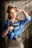 Young Retro Woman Holding Instant Camera Stock Images