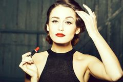 Young retro woman with lipgloss stock photo