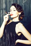 Young retro woman with lipgloss royalty free stock photography