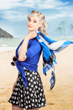 Young retro woman on a tropical beach vacation stock photo