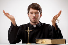 Young reverend with rosary and the Bible stock photos