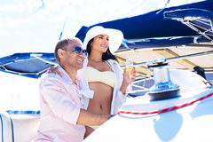 Young, rich and attractive couple on a sailing boat Stock Image