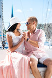 Young, rich and attractive couple on a sailing boat Royalty Free Stock Photo