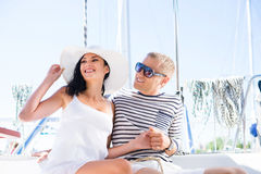 Young, rich and attractive couple on a sailing boat stock photo