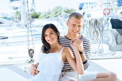 Young, rich and attractive couple on a sailing boat royalty free stock photos