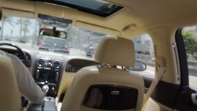 Young rich woman traveling by car, private chauffeur driving expensive auto. Stock footage stock footage