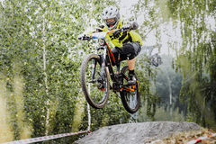Young rider athlete on bicycle jump over obstacles Stock Images