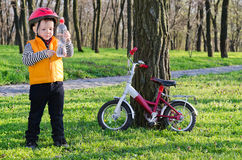 Young rider checking his bottled Stock Photography