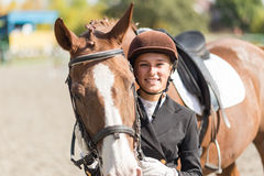 Young rider girl with her horse Royalty Free Stock Image