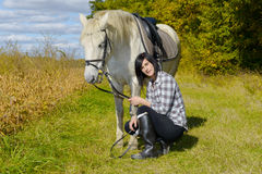 Young rider girl with her white horse Stock Photos