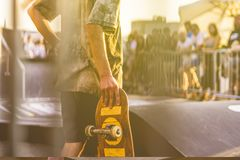 Young rider holding a skateboard on competition tournament stock images