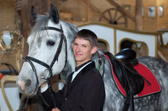 Young rider with race-horse Royalty Free Stock Image