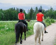 Young riders. Young female riders in a country side landscape Royalty Free Stock Image