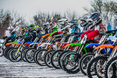 Young riders on motorcycles at starting line Royalty Free Stock Photography