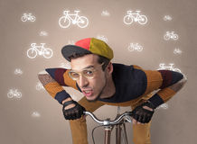 Lunatic cyclist with bike on the background Stock Photos